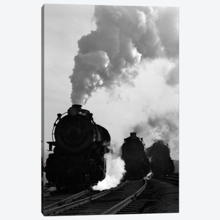 1930s-1940s Head-On View Of Three Steam Engines Silhouetted Against Billowing Smoke And Steam Outdoor Canvas Print #VTG153} by Vintage Images Canvas Artwork