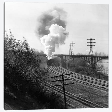1940s Aerial Of Train Traveling Along River Under Bridge Billowing Smoke Near Columbus Ohio Canvas Print #VTG198} by Vintage Images Canvas Art