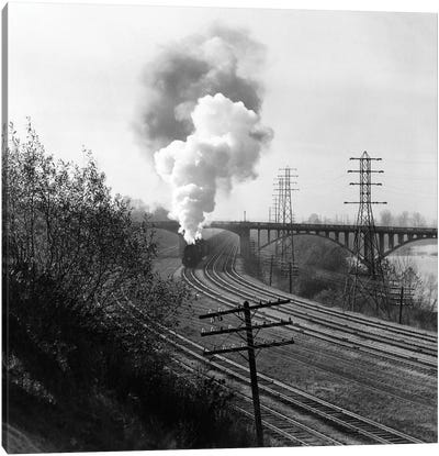 1940s Aerial Of Train Traveling Along River Under Bridge Billowing Smoke Near Columbus Ohio Canvas Art Print