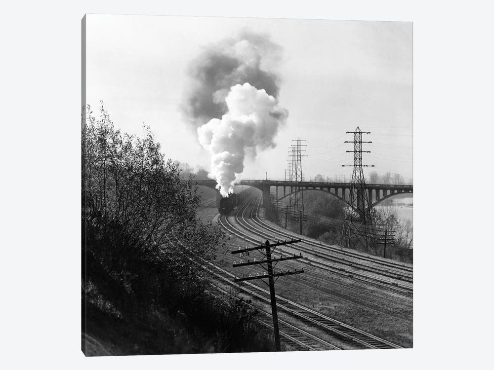 1940s Aerial Of Train Traveling Along River Under Bridge Billowing Smoke Near Columbus Ohio by Vintage Images 1-piece Canvas Artwork