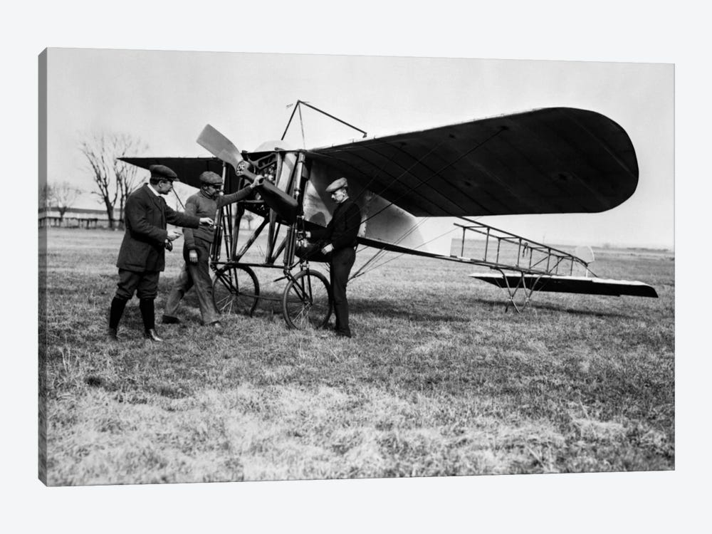1910s Group Of Three Men Standing In Front Of Early Monoplane One With Hand On Propeller by Vintage Images 1-piece Canvas Art