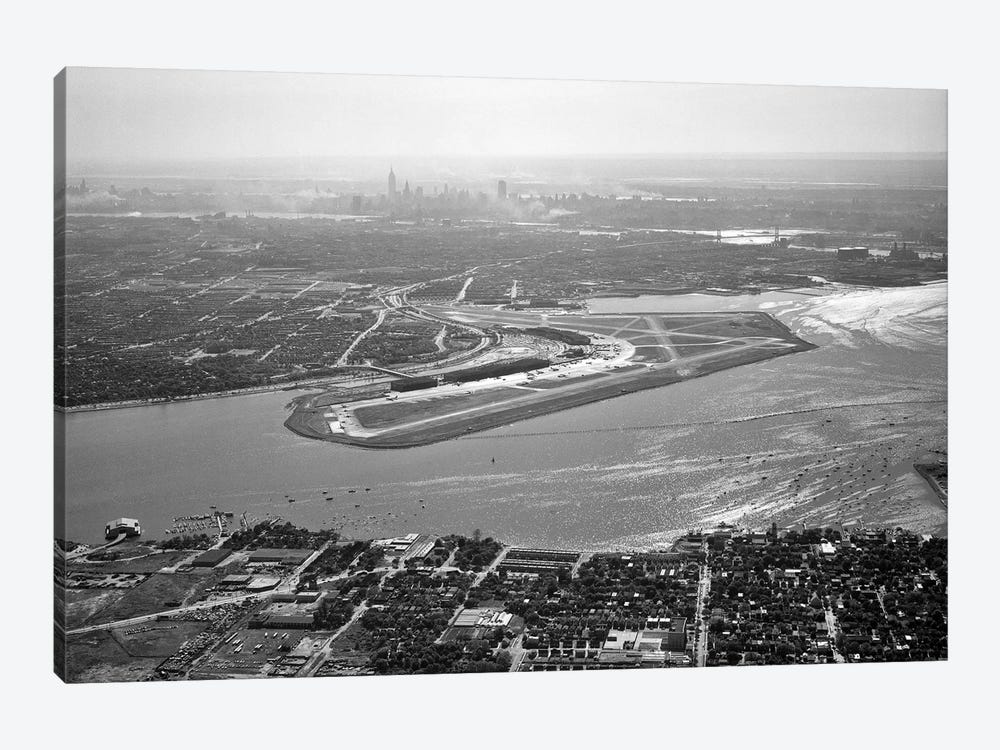 1950s Aerial Across Flushing Bay La Guardia Airport College Point Queens Manhattan Skyline In Distance Looking West by Vintage Images 1-piece Canvas Art