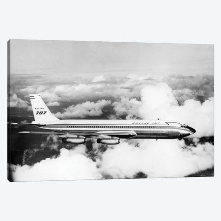 1950s Boeing 707 Passenger Jet Flying Through Clouds Canvas Print #VTG277} by Vintage Images Canvas Artwork