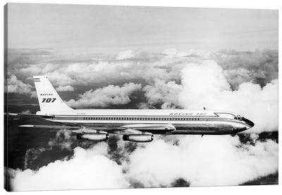 1950s Boeing 707 Passenger Jet Flying Through Clouds Canvas Art Print