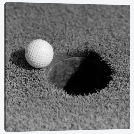 1950s Close-Up Of Golf Ball On Green On Very Edge Of Cup Canvas Print #VTG283} by Vintage Images Canvas Artwork