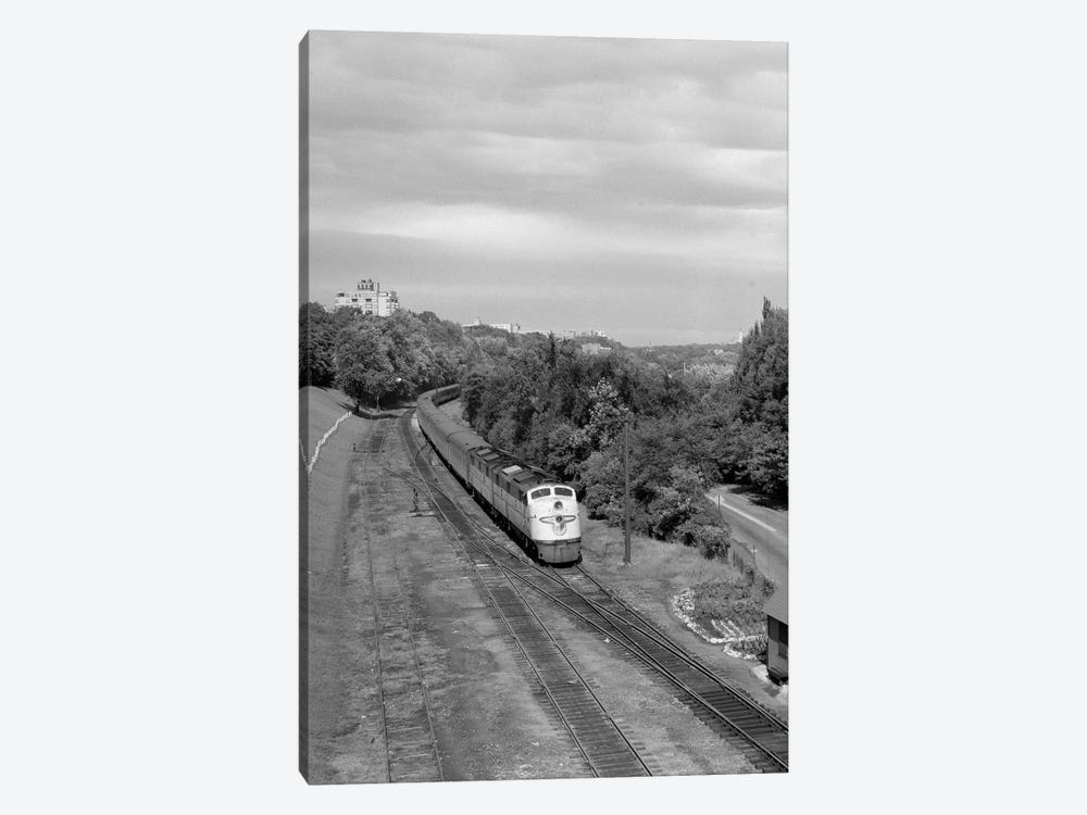 1950s Overhead View Of Streamlined Front Cab Diesel Locomotive Passenger Railroad Train Passing Through Suburban Area by Vintage Images 1-piece Canvas Art