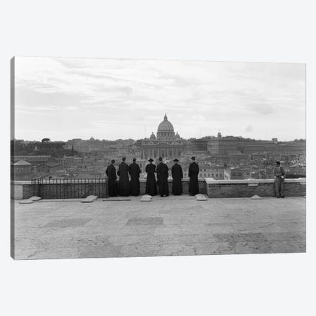 1950s Rome Italy Back View Of Student Priests Lined Up By Wall Overlooking City With View Of St. Peters Basilica In Background Canvas Print #VTG337} by Vintage Images Canvas Art Print