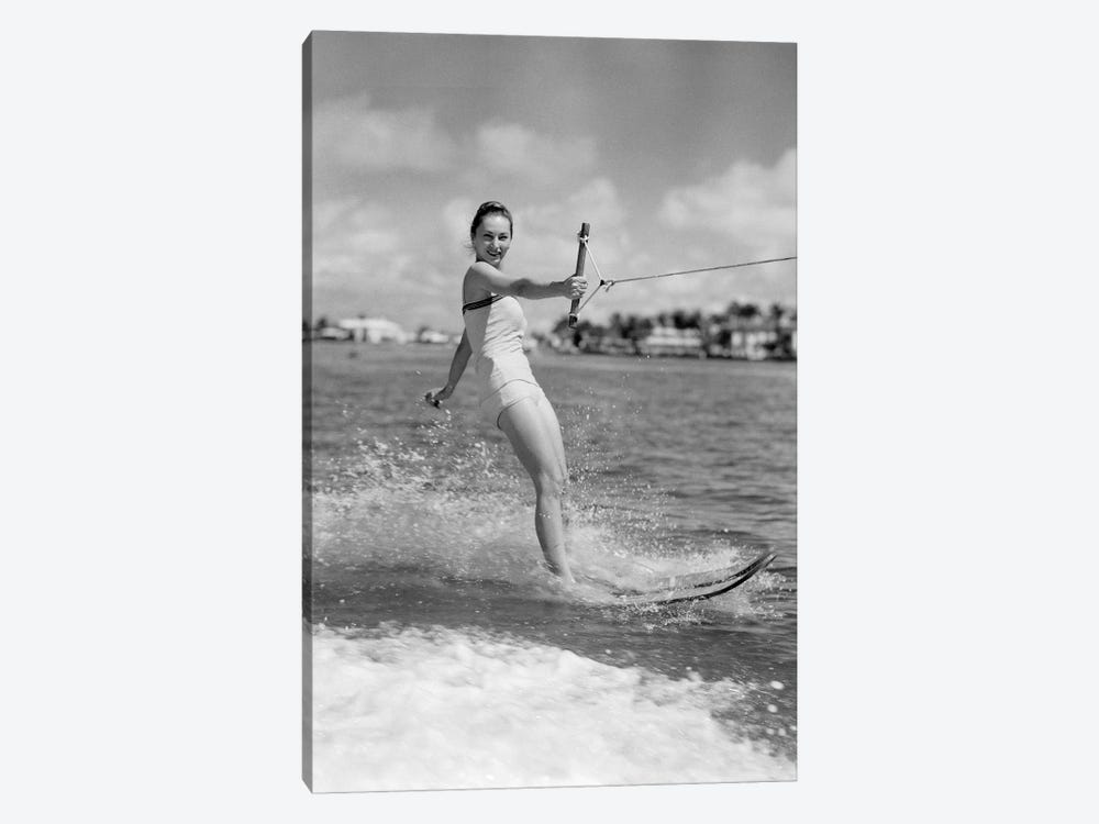1950s Smiling Woman In Bathing Suit Water Skiing Waving One Hand Looking At Camera by Vintage Images 1-piece Art Print