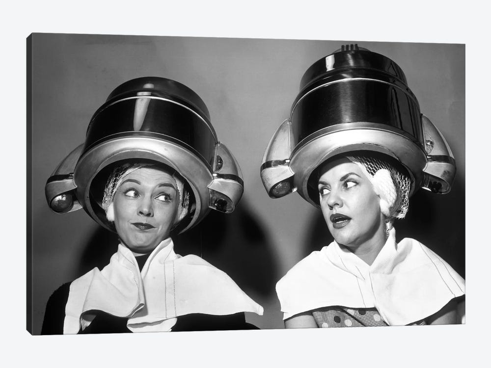 1950s Two Women Sitting Together Gossiping Under Hairdresser Hair Dryer by Vintage Images 1-piece Canvas Wall Art