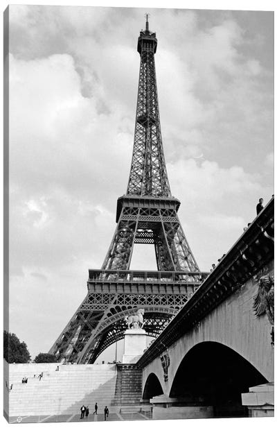1920s Eiffel Tower With People Walking Up Stairs & Standing On Bridge In Foreground Canvas Art Print