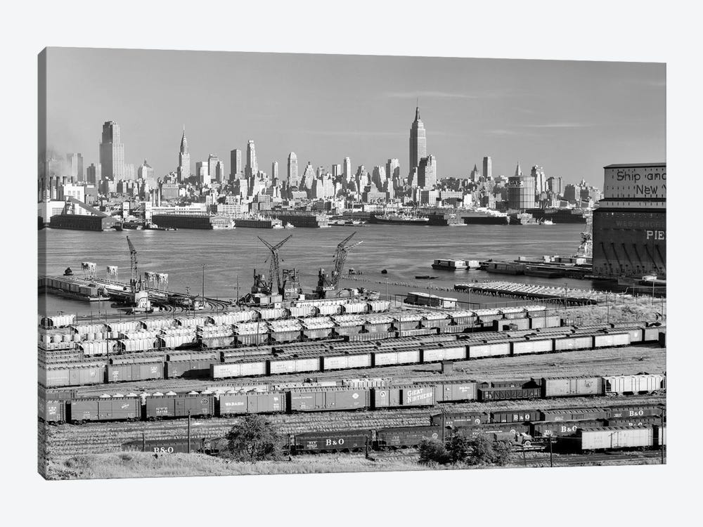 1950s-1960s Skyline Midtown Manhattan From Across The Hudson River Railroad Tracks Foreground In West New York NJ USA by Vintage Images 1-piece Canvas Wall Art