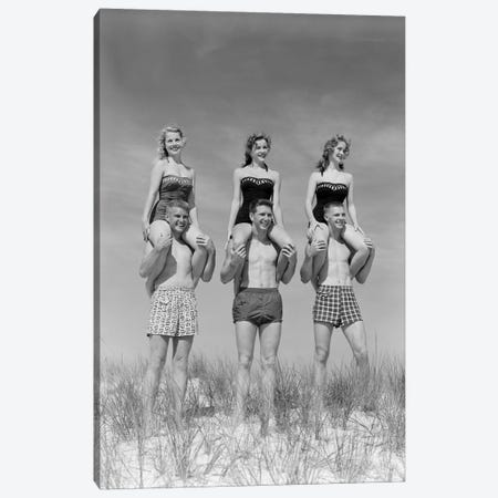 1950s-1960s Three Couples At Beach On Dunes With Women In Identical Bathing Suits Sitting On Men's Shoulders Canvas Print #VTG386} by Vintage Images Canvas Art