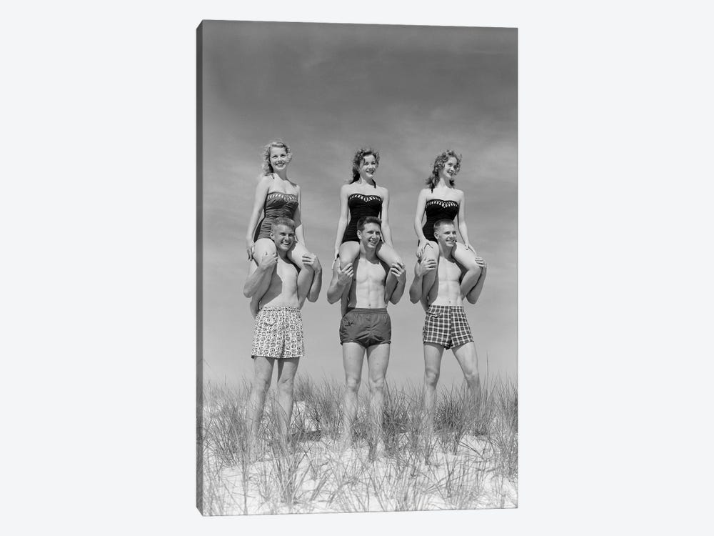1950s-1960s Three Couples At Beach On Dunes With Women In Identical Bathing Suits Sitting On Men's Shoulders by Vintage Images 1-piece Canvas Artwork