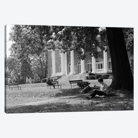 1960s Anonymous Silhouetted Female College Student Sitting Under Tree Studying With Campus Building In Background Canvas Print #VTG400} by Vintage Images Canvas Art