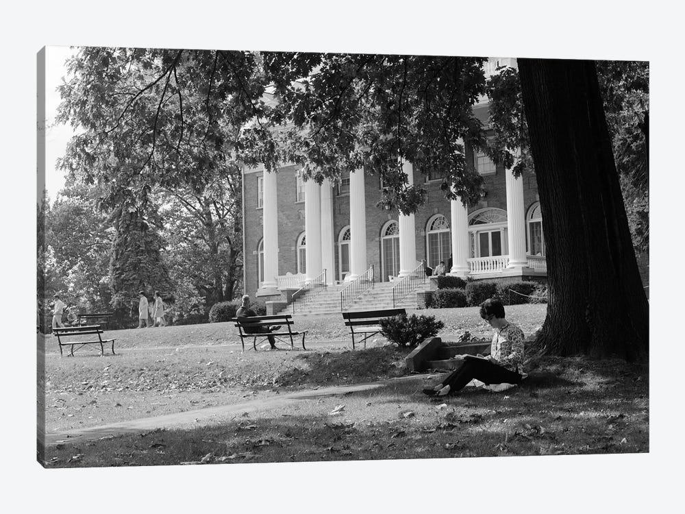 1960s Anonymous Silhouetted Female College Student Sitting Under Tree Studying With Campus Building In Background by Vintage Images 1-piece Canvas Print