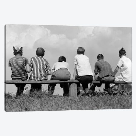 1960s Back View Of Six Anonymous Boy Baseball Players Sitting On Bench Canvas Print #VTG406} by Vintage Images Art Print