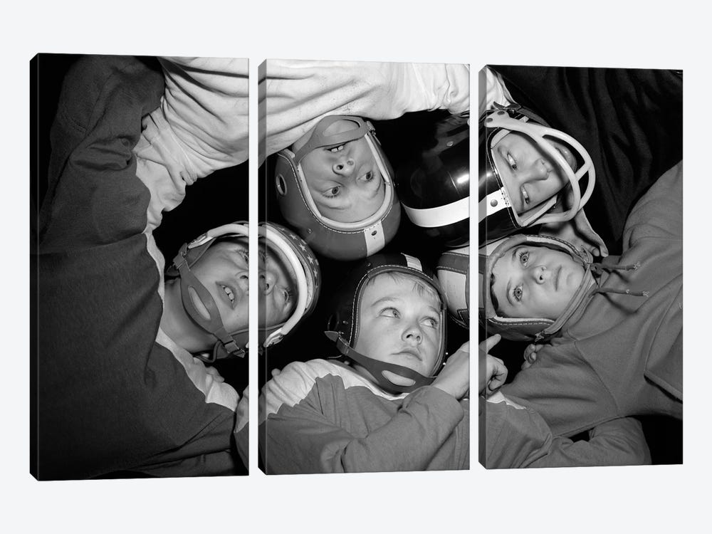 1960s Five Boys In Huddle Wearing Helmets & Football Jerseys The View Is From Inside The Huddle Looking Up by Vintage Images 3-piece Art Print
