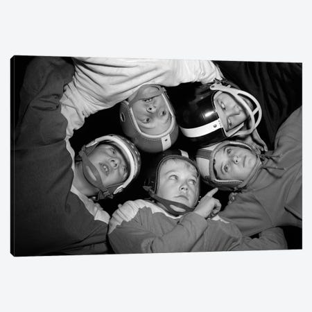 1960s Five Boys In Huddle Wearing Helmets & Football Jerseys The View Is From Inside The Huddle Looking Up Canvas Print #VTG422} by Vintage Images Canvas Art