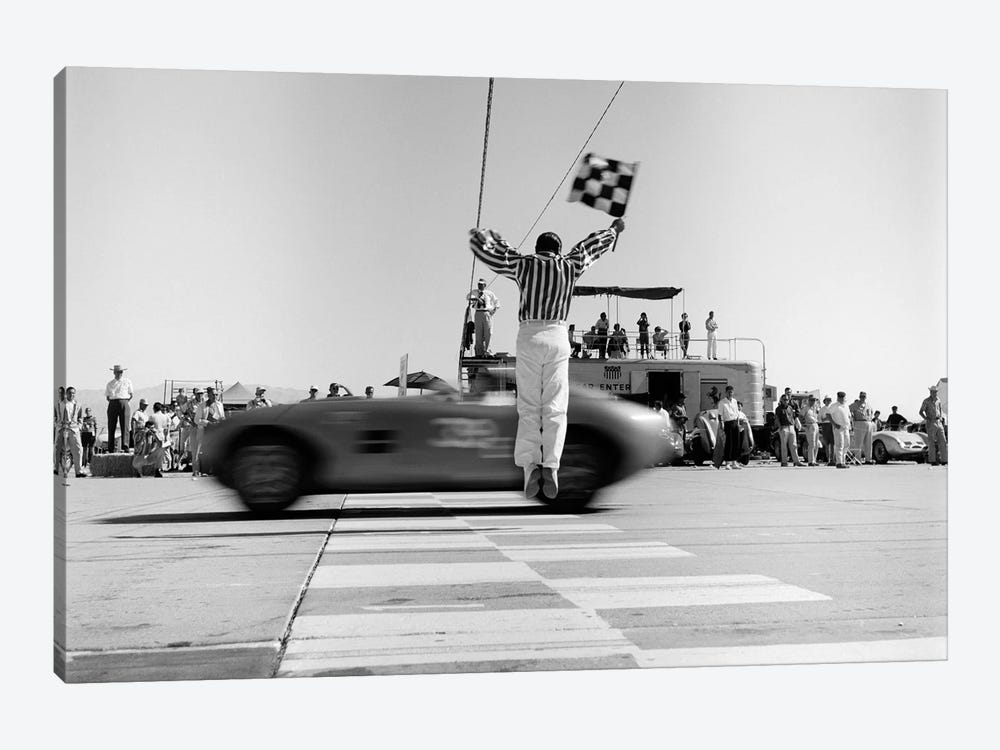 1960s Man Jumping Waving Checkered Flag For Winning Sports Car Crossing The Finish Line by Vintage Images 1-piece Canvas Wall Art
