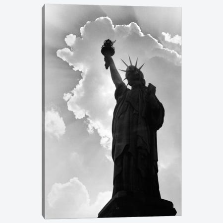 1960s Silhouette Of Statue Of Liberty With Sun Ray Clouds Behind Canvas Print #VTG458} by Vintage Images Art Print