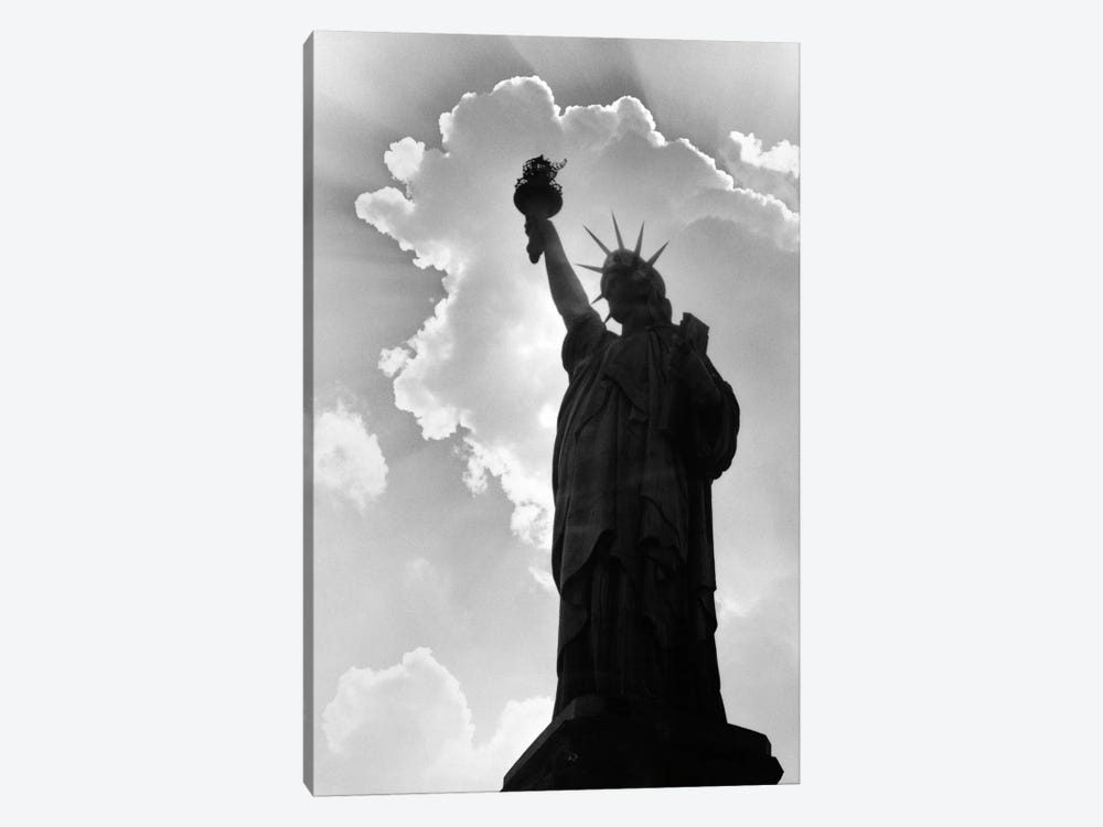 1960s Silhouette Of Statue Of Liberty With Sun Ray Clouds Behind by Vintage Images 1-piece Canvas Wall Art