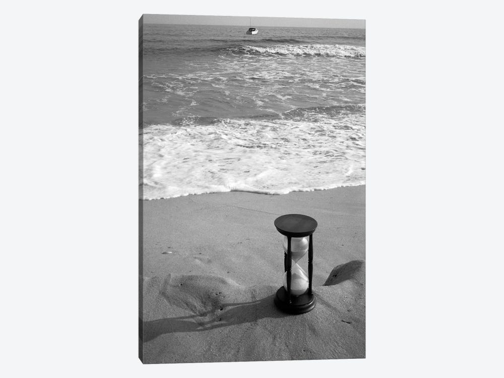 1960s Still Life Of Hourglass At Edge Of Beach Sand With Waves Washing Up On Shore And Power Boat Passing Offshore Tempus Fugit by Vintage Images 1-piece Canvas Art