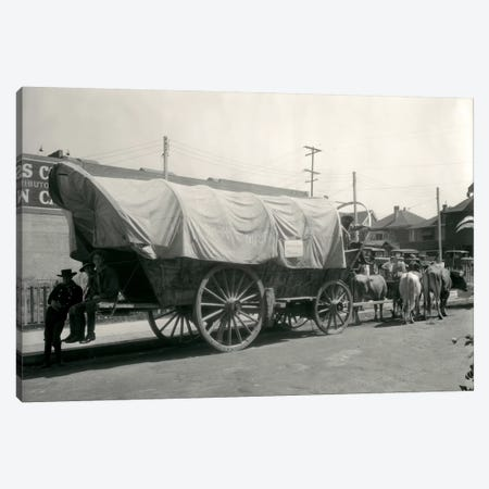 1920s Ox Drawn Conestoga Covered Wagon Parked Along Street Canvas Print #VTG47} by Vintage Images Art Print