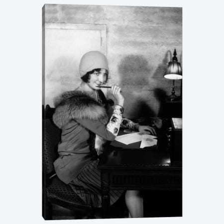 1920s Smiling Woman With Pen To Lips Wearing Cloche Hat And Fur Collar Coat Writing A Letter At Hotel Lobby Desk With Lamp Canvas Print #VTG49} by Vintage Images Canvas Wall Art