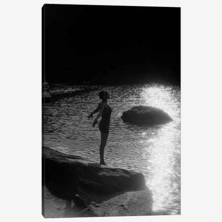 1920s Sunset Silhouette Of Anonymous Woman Standing On A Rock Near Water About To Dive In Canvas Print #VTG50} by Vintage Images Art Print