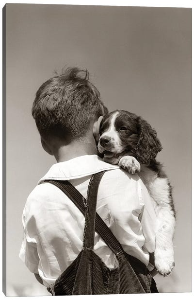 1930s-40s Back View Of Boy In Corduroy Overalls Holding Springer Spaniel Puppy Canvas Art Print