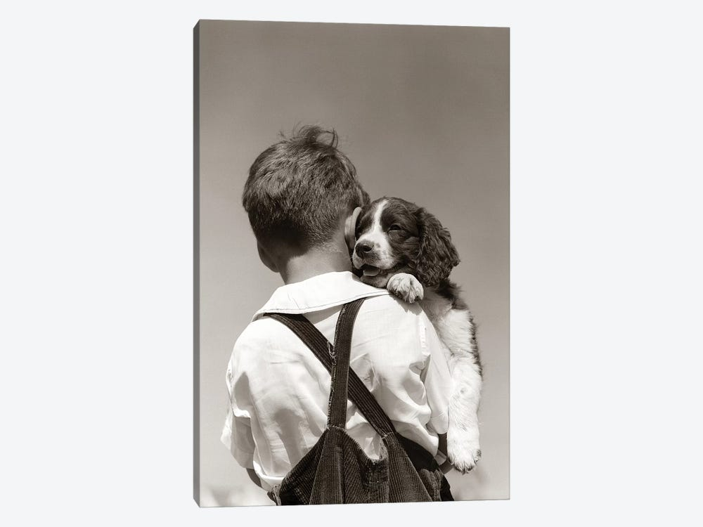 1930s-40s Back View Of Boy In Corduroy Overalls Holding Springer Spaniel Puppy by Vintage Images 1-piece Canvas Artwork