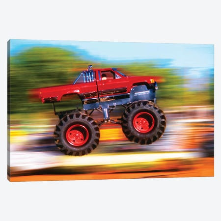Big Wheeled Red Truck Jumping Blurred Background Canvas Print #VTG614} by Vintage Images Canvas Artwork