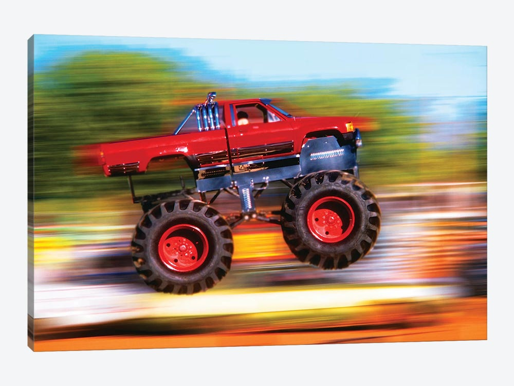 Big Wheeled Red Truck Jumping Blurred Background by Vintage Images 1-piece Art Print