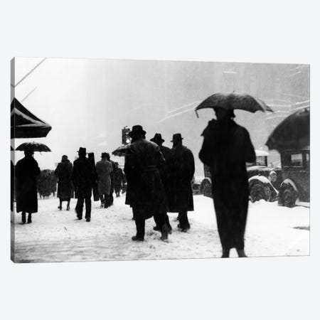 1920s-1930s Crowd Of Anonymous Pedestrians Silhouetted By Snow Storm Walking On City Street Sidewalk Canvas Print #VTG62} by Vintage Images Canvas Wall Art