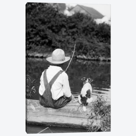 1920s-1930s Farm Boy Wearing Straw Hat And Overalls Sitting On Log With Spotted Dog Fishing In Pond Canvas Print #VTG63} by Vintage Images Canvas Artwork