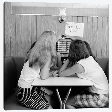 1960s Four Teenage Girls Putting Coins In Slot Of Small Individual Juke Box Of Diner Soda Shop Canvas Print #VTG657} by Vintage Images Canvas Wall Art