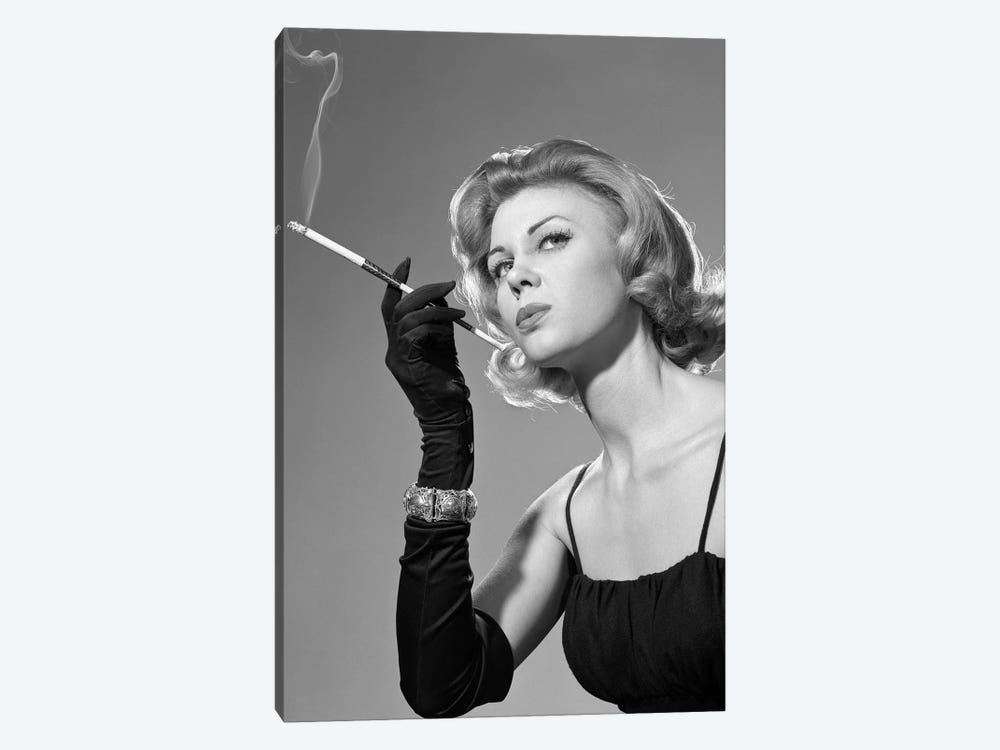 1960s Sexy Sultry Woman In Black Evening Dress Long Black Gloves Bracelet Smoking Cigarette In Long Cigarette Holder by Vintage Images 1-piece Canvas Print