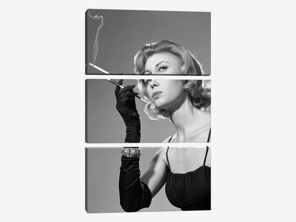 1960s Sexy Sultry Woman In Black Evening Dress Long Black Gloves Bracelet Smoking Cigarette In Long Cigarette Holder by Vintage Images 3-piece Canvas Art Print
