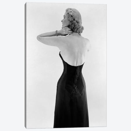 1950S Blonde Woman Wearing Black Strapless Gown Hands And Arms Reaching To Her Neck Canvas Print #VTG666} by Vintage Images Art Print