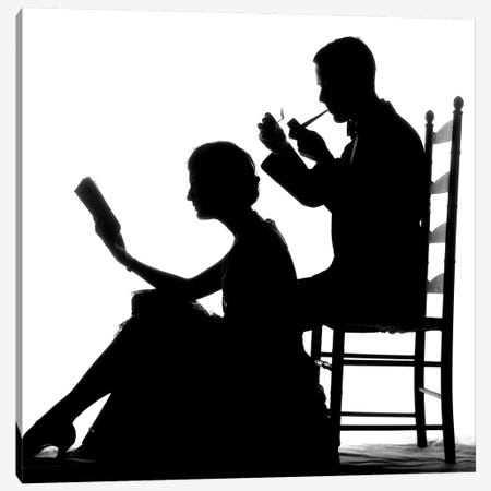 1920s 1930s Anonymous Silhouetted Man In Ladder-Back Chair Smoking Pipe With Woman Seated On Floor In Front Of Him Reading Book Canvas Print #VTG673} by Vintage Images Canvas Print