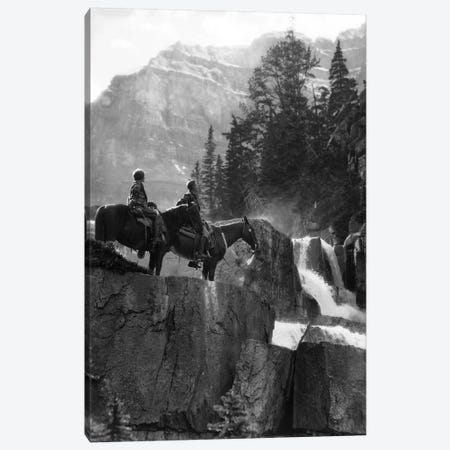 1920s 1930s Couple Man Woman On Horses By Waterfall In Pine Forest Giants Steps Paradise Valley Alberta Canada Canvas Print #VTG674} by Vintage Images Canvas Art