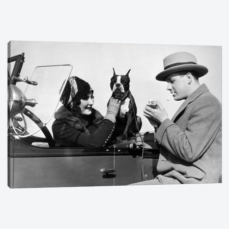1920s Woman Sitting In Driver's Seat Convertible Car With Boxer Dog Man Lighting Cigarette Canvas Print #VTG678} by Vintage Images Canvas Art Print