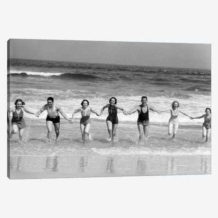 1930s Group 7 People Holding Hands Running Out Of Surf Onto Beach Canvas Print #VTG683} by Vintage Images Canvas Artwork