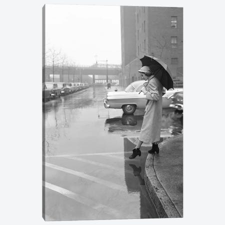1950s Woman In Rain Coat Hat Boots Holding Umbrella Crossing City Street In Wet Foul Weather Canvas Print #VTG690} by Vintage Images Canvas Art Print