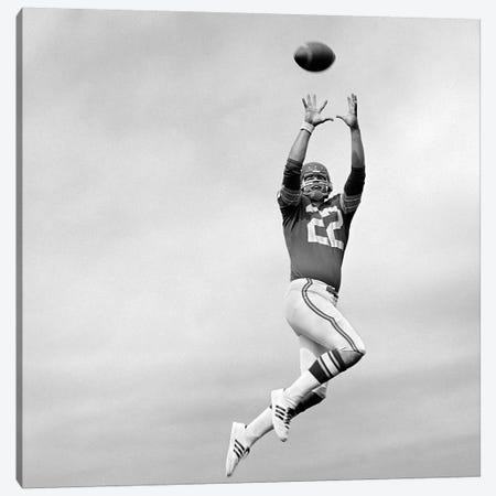 1970s Player Jumping To Catch Football Pass Canvas Print #VTG698} by Vintage Images Art Print