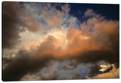 Sunlight Coming Through Rolling Dark Storm Clouds Canvas Art Print