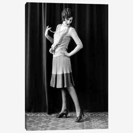 1920s Flapper Woman Posing Hand On Hip Holding String Of Pearls Stretching Leg Checking Hosiery Seams Canvas Print #VTG746} by Vintage Images Canvas Artwork