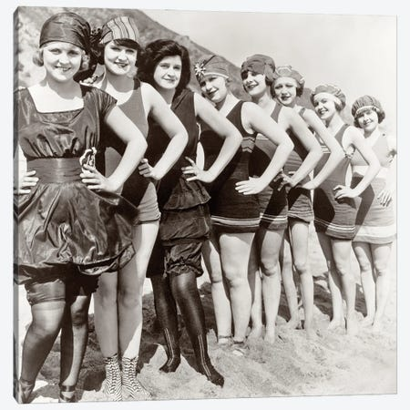 1920s Group Of Smiling Women Wearing One Piece Bathing Suits And Caps Posing Lined Up On Beach Looking At Camera Canvas Print #VTG747} by Vintage Images Canvas Artwork
