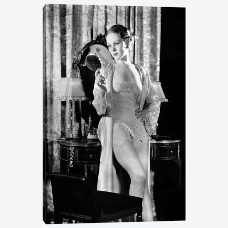 1930s Young Woman In Her Boudoir Wearing Silk And Lace Lingerie Looking Into Hand-Held Mirror Canvas Print #VTG766} by Vintage Images Canvas Art