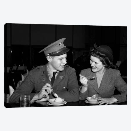1940s Smiling Couple Man Soldier In Army Uniform And Woman Girlfriend Sitting At Soda Fountain Counter Eating Dish Of Ice Cream Canvas Print #VTG779} by Vintage Images Canvas Artwork